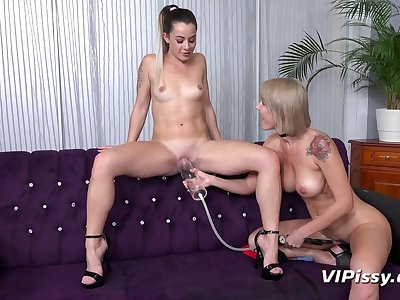 Busty milf and a young lesbian have piss fetish sex