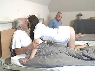 Young nurse Nana Garnet is sucking lasting dicks of two pensioners